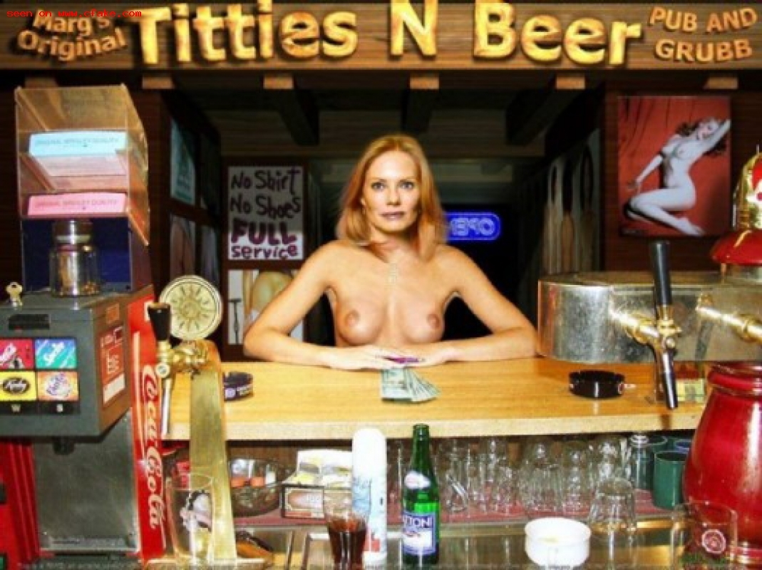 Cheerful redhead in black loves beer and lo